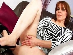 MILF with unshaved twat masturbates