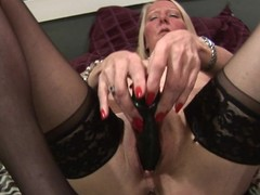 Lustful golden-haired housewife playing with the brush soaked dirty cleft