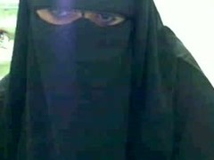 Veiled Arabian hussy makes some hawt livecam porn by lifitng upon layers of the brush clothes and skimpy a set of natural jugs so big it will take your breath away