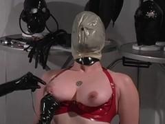 Red latex slave enjoys breath play