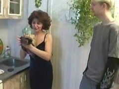 Russian mom plus juvenile gentleman playing far kitchen