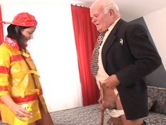Brunette sweetheart in firefighter uniform acquires drilled by old beggar