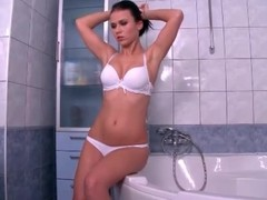 X-rated brunette hair undresses and takes a washroom